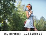 happy young girl on the tennis... | Shutterstock . vector #1255155616