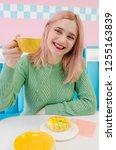 beautiful young girl drinking... | Shutterstock . vector #1255163839