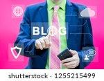 businessman presses button blog ... | Shutterstock . vector #1255215499