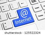 internet concept on blue button ... | Shutterstock . vector #125522324