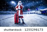 santa claus on airport and snow ...   Shutterstock . vector #1255298173