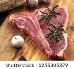 raw  t bone steak seasoned with ... | Shutterstock . vector #1255305379