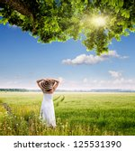 Girl In A Meadow Under A Tree