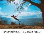 happy girl have fun swinging... | Shutterstock . vector #1255357810