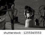 a fishermen cutting some raw... | Shutterstock . vector #1255365553