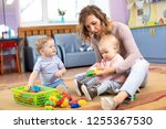 mentor and 1 years old babies... | Shutterstock . vector #1255367530