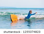 happy boy   young surfer... | Shutterstock . vector #1255374823