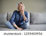 modern senior woman in all... | Shutterstock . vector #1255403956