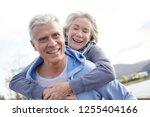fun loving senior couple... | Shutterstock . vector #1255404166