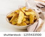 ruddy baked potato wedges with...   Shutterstock . vector #1255433500