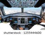 cockpit of passenger aircraft... | Shutterstock . vector #1255444600
