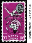 Small photo of ETHIOPIA - CIRCA 1963 : A stamp printed in Ethiopia shows image of emperor Haile Selassie and globe with map of a African continent, with the inscription in Amharic , circa 1963