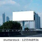 blank billboard on blue sky... | Shutterstock . vector #1255468936