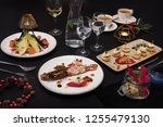 tasty restaurant dishes  cooked ...   Shutterstock . vector #1255479130