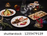 tasty restaurant dishes  cooked ...   Shutterstock . vector #1255479139