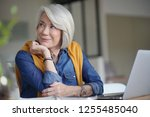 beautiful senior woman looking ... | Shutterstock . vector #1255485040