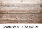 empty wooden shelve in front of ... | Shutterstock . vector #1255550329