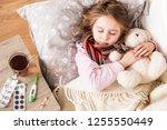 little ill girl sleep hugging... | Shutterstock . vector #1255550449