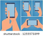 hand holding phone. flat style. ... | Shutterstock .eps vector #1255573399