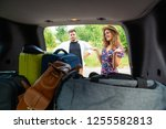 couple put bags in car trunk.... | Shutterstock . vector #1255582813