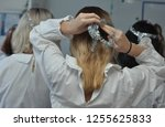 close up of a girl fixing her... | Shutterstock . vector #1255625833