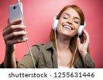 shot of beautiful smiling woman ...   Shutterstock . vector #1255631446