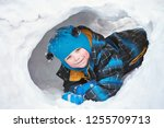 funny little boy playing with... | Shutterstock . vector #1255709713