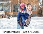 happy children playing in the... | Shutterstock . vector #1255712083