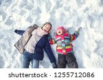 happy children lying on the... | Shutterstock . vector #1255712086