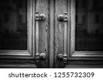 old antique handles on wooden... | Shutterstock . vector #1255732309