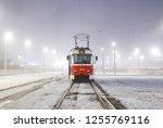 old tram in the night fog. kiev ... | Shutterstock . vector #1255769116
