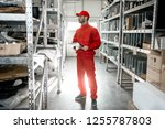 warehouse worker in red uniform ... | Shutterstock . vector #1255787803