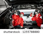 two auto service workers in red ... | Shutterstock . vector #1255788880