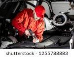 handsome auto service worker in ... | Shutterstock . vector #1255788883