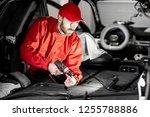 handsome auto service worker in ... | Shutterstock . vector #1255788886