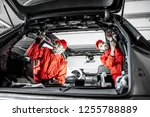 two auto service workers in red ... | Shutterstock . vector #1255788889