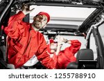 two auto service workers in red ... | Shutterstock . vector #1255788910