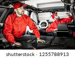 two auto service workers in red ... | Shutterstock . vector #1255788913
