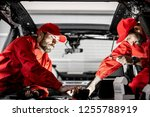 two auto service workers in red ... | Shutterstock . vector #1255788919