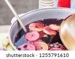 mulled wine prepared in iron... | Shutterstock . vector #1255791610