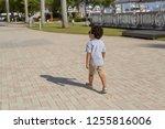 a confident little boy with... | Shutterstock . vector #1255816006