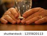 elderly man's hands holding... | Shutterstock . vector #1255820113