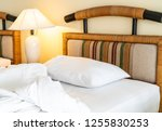 rumple pillow on bed decoration ... | Shutterstock . vector #1255830253