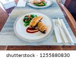 a meal on private jet table.... | Shutterstock . vector #1255880830