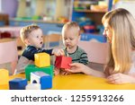 cute babies play with blocks.... | Shutterstock . vector #1255913266
