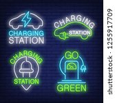 car charging station neon sign... | Shutterstock .eps vector #1255917709
