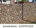 gabions as visual protection | Shutterstock . vector #1255919263