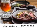 sliced beef tenderloin roasted... | Shutterstock . vector #1255932526