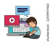 little schoolboy with laptop... | Shutterstock .eps vector #1255947463