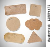 Vector old used brown cardboard paper labels attached with staples